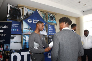 Student talks to recruiter at annual career fair